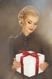 Woman with a present Stock Photo