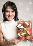 Woman with a present Royalty Free Stock Photos