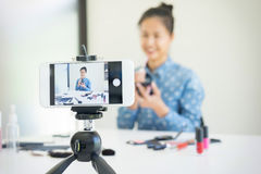 Woman present beauty product and broadcast live video to social Stock Photography