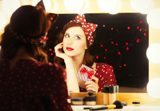 Woman with present box near a mirror. Stock Images