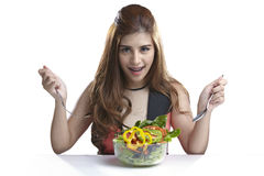 Woman present eating salad for Healthy. Asian woman attractive pretty showing and present eating salad. Portrait of beautiful smiling and happy mixed Asian Stock Image