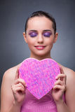 The woman with present in heart shaped box Stock Photos
