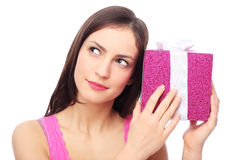 Woman with present looking up Stock Images