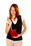 Woman with present - necklace. Frontal shot. Beautiful red-haired woman with a love gift - necklace in a red box royalty free stock images