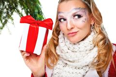 Woman with present wrapped in white paper Royalty Free Stock Photography
