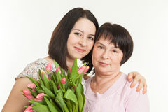 The woman presented a bouquet Stock Images