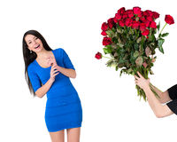 Woman presented with a large bouquet of red roses. Brunette woman with a big bouquet of red roses stock photography