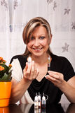 Woman presented utensils for electric cigarette Royalty Free Stock Photo