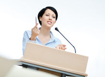 Woman presenter at the podium Royalty Free Stock Photos