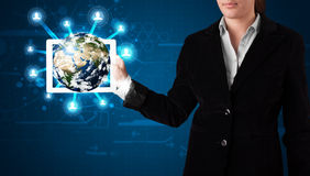 Woman presenting 3d earth globe in modern tablet Royalty Free Stock Images