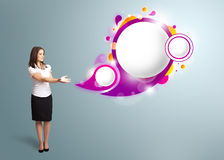 Woman presenting abstract speech bubble copy space. Attractive young woman presenting abstract speech bubble copy space Royalty Free Stock Photo