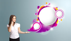 Woman presenting abstract speech bubble copy space and making phone call Royalty Free Stock Images