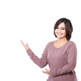 Woman presenting blank area Royalty Free Stock Photos