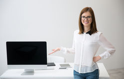 Woman presenting blank monitor screen Stock Image