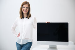 Woman presenting blank monitor screen Stock Photography