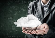 Woman presenting cloud in her hand. stock images