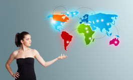 Woman presenting colorful world map Royalty Free Stock Photo