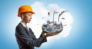 Woman Presenting Construction Model . Mixed Media Stock Photos
