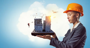 Woman Presenting Construction Project. Mixed Media Royalty Free Stock Photo