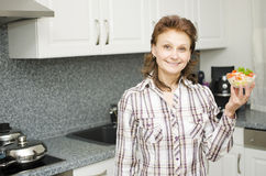 Woman presenting a cup with salad Royalty Free Stock Images