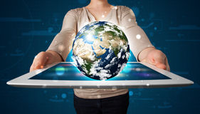 Woman presenting 3d earth globe in modern tablet Stock Images