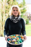 Woman presenting easter eggs royalty free stock photography