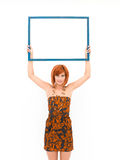 Woman presenting an empty frame Stock Images