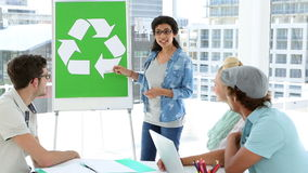 Woman presenting environmental awareness plan to colleagues stock video footage