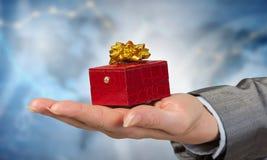 Woman presenting gift box . Mixed media Stock Photography
