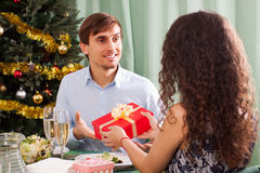 Woman presenting gift to man Stock Photos