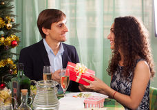 Woman presenting gift to man Stock Images