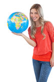 Woman presenting a globe Royalty Free Stock Photo