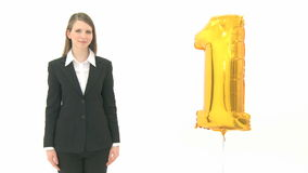 Woman presenting the golden number one Stock Photos