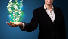 woman presenting green glowing dollar sign Stock Images