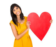 Woman presenting heart Royalty Free Stock Photo