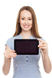 Woman presenting her digital tablet Royalty Free Stock Images