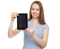 Woman presenting her digital tablet Stock Images