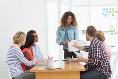 Woman presenting ideas to young designers having a meeting Stock Photo