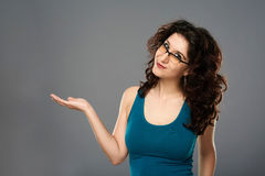 Woman presenting an invisible product Stock Photos