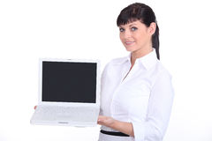 Woman presenting a laptop Stock Photography