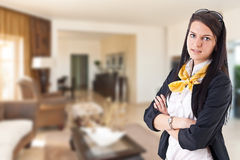 Woman presenting living room Royalty Free Stock Image