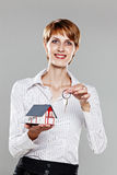 Woman presenting a model house and keys Stock Images
