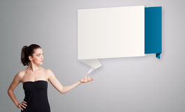 Woman presenting modern origami copy space Stock Photos
