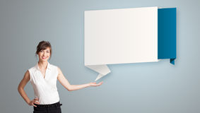 Woman presenting modern origami copy space Stock Photography