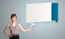 Woman presenting modern origami copy space Stock Image