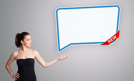woman presenting modern speech bubble copy space Royalty Free Stock Photos