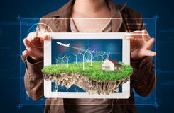 Woman presenting a perfect ecology land with a house and windmil Royalty Free Stock Images