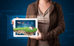 Woman presenting a perfect ecology land with a house and windmil Stock Images