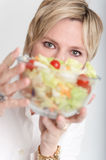 Woman presenting a salad Royalty Free Stock Image