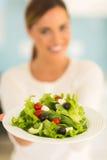Woman presenting salad Royalty Free Stock Image